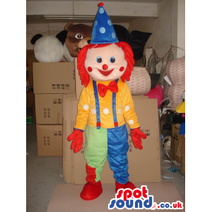 Funny Cute Colorful Clown Mascot With A Bow Tie And Red Hair -