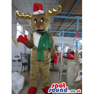 Reindeer Animal Mascot Wearing A Green Scarf And Gloves -