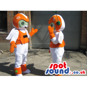 Two Orange And White Space Alien Creatures With Antennae -