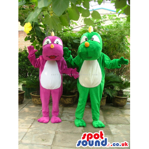 Two Dragon Mascots In Green And Purple With A White Belly -