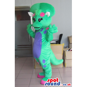 Green Dinosaur Mascot With A Blue Belly And A Bone - Custom