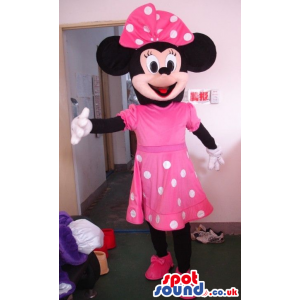 Minnie Mouse Disney Mascot Wearing A Pink Dress With Dots -