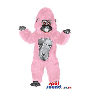 Monkey mascot in pink colour with bare foot looking at you -