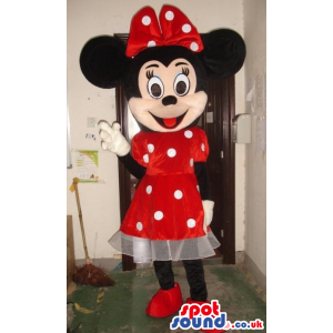 Minnie Mouse Disney Mascot Wearing A Red Dress With Dots -