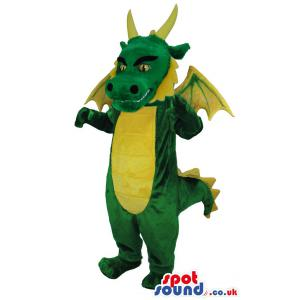 Big green and yellow friendly dragon mascot with red hair -