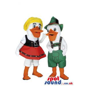 Two little girl bad boy ducks with very colourful clothes -