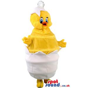 Yellow chicken mascot in cute smile and with her shell - Custom