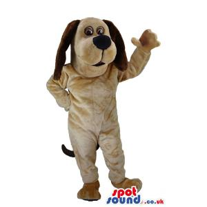 Snoopy dog mascot with hanging dark brown ears and waving hand