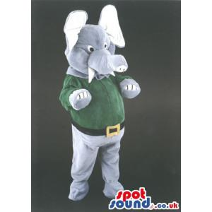 Elephant mascot with a tusk wearing a green t-shirt and belt -