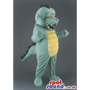 Green and yellow dinosaur mascot with open mouth laughing -