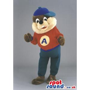 Squirrel mascot with blue cap, red top and a peacock blue