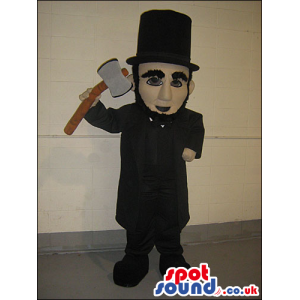 Chimney Sweep Human Mascot Wearing Top Hat With A Hammer -