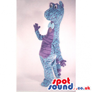Blue Dinosaur Mascot With Purple Dots Wearing A Bow Tie -