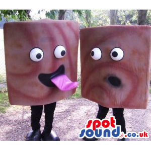 Two Are A Funny Pair Of Squared Candies With Comical Faces -