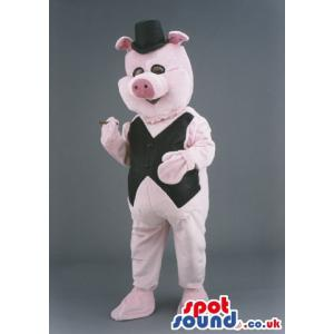 Pink pig mascot with a black jacket and hat - Custom Mascots