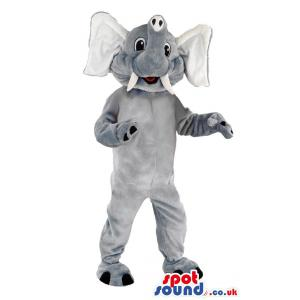 Elephant mascot with a tusk standing and smiling at you -