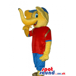 Funny Yellow Elephant Mascot Wearing Red And Blue Clothes -