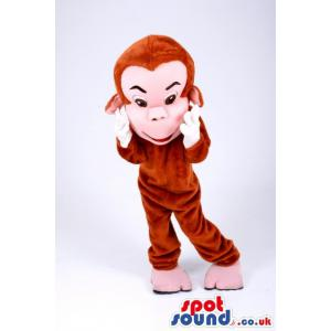 Cute monkey mascot with hands on the cheeks looking happy -