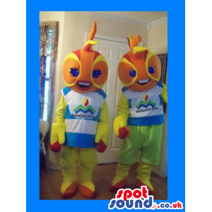 Orange Boy And Girl Fish Couple Mascots Wearing Clothes And
