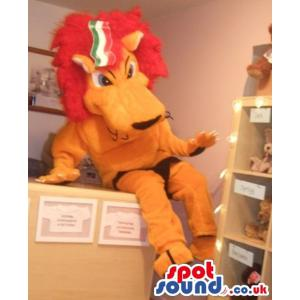 Cute king lion mascot is smiling with brown colour jumper -