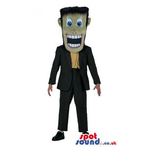 Man mascot with a black suit, yellow shirt and lovely shoes -