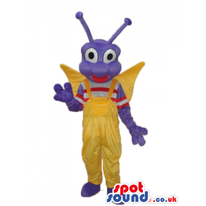 Happy Purple Butterfly Mascot With Yellow Overalls And Wings -