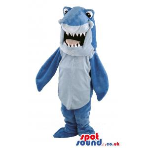 Blue shark mascot with his mouth open showing his sharp teeth -