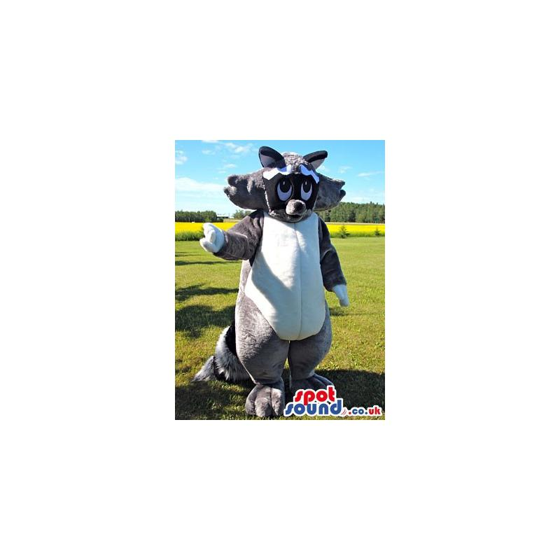 Giant black and white mascot with a cute look waving hand -