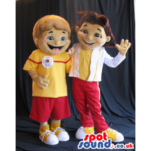 Boy And Girl Couple Mascot Wearing Yellow And Red Sports