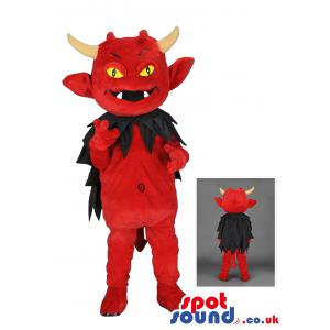 Red devil mascot with black cloak and bright yellow eyes -