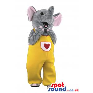 Cute little elephant in a yellow jumper with a red heart in it
