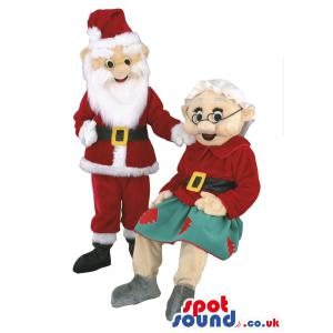 Santa and his wife, wearing their red colour christmas costumes