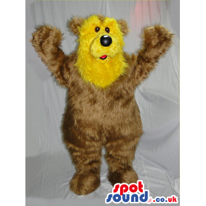 Fluffy teddy bear mascot with yellow face and black round nose