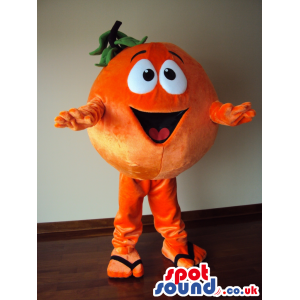 Orange mascot open mouth smile, legs and arms and green leaves