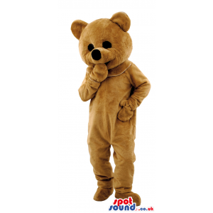 Tall brown teddy bear mascot with black eyes and round black
