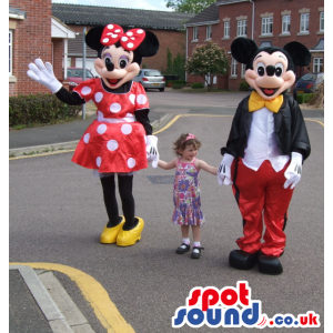 Mickey mouse in smart outfit and minnie mouse in polka dress -
