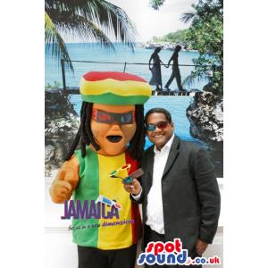 Rastafarian mascot in red, yellow and green rastafarian colors