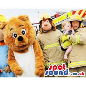 Standing bear mascot and fireman mascot in full fireman uniform