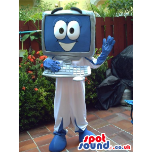 Grey and blue computer mascot with smiling face on screen -
