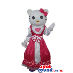 Kitty Cat Cartoon Mascot Wearing A Red Dress With A Heart. -