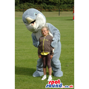 Open beak with tongue, grey dolphin mascot with white
