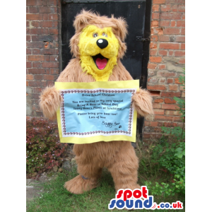 Big brown fluffy bear mascot with smiling yellow face - Custom