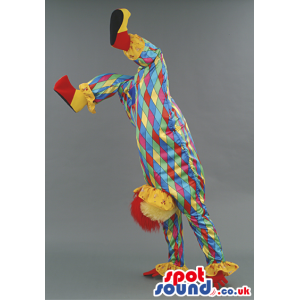 Red haired clown mascot with multicolored diamond pattern