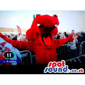 Welsh red dragon mascot with mouth open and sharp white teeth -