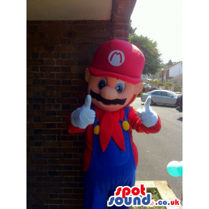 Giant Super Mario mascot in red and blue plumber costume -