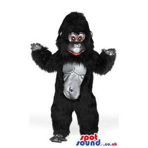 Fluffy giant black gorilla mascot with brown eyes and red lips