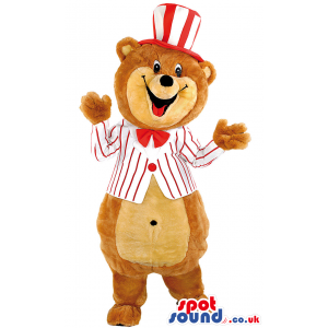 Bear mascot wearing matching white suit and hat with red