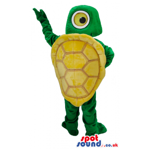Standing green turtle with big round eyes and yellow shell -