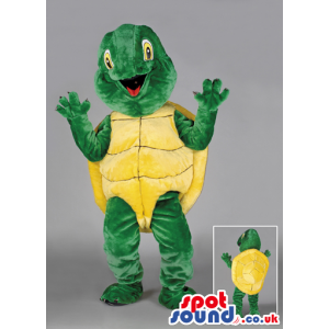 Joyous looking green tortoise with yellow carapace and eyes -