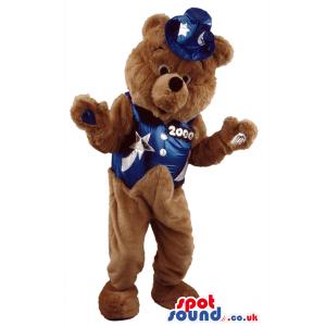 Teddy bear mascot wearing blue waistcoat with moons and stars -